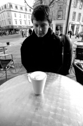 Paul contemplating his coffee.